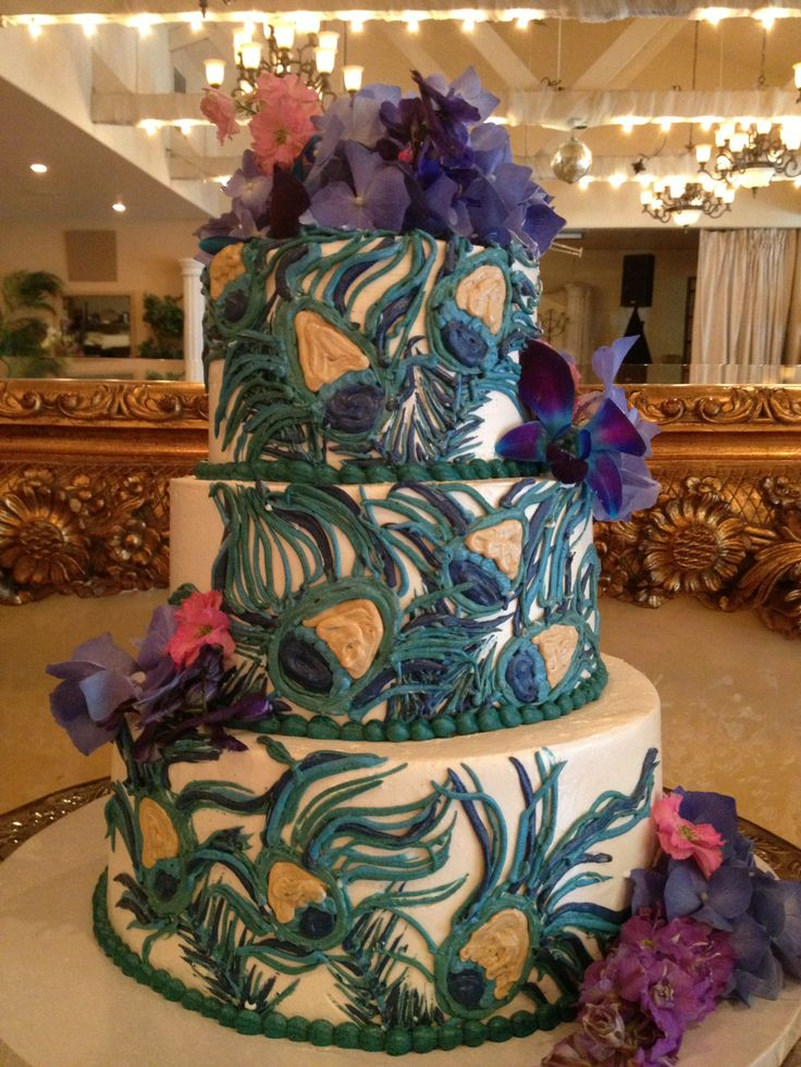 wedding bakeries in sacramento ca%0A Teal and purple buttercream wedding cake with fresh flowers and hand piped  peacock feather buttercream details