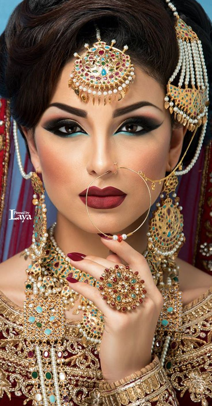 MODERN - 4 the makeup artist here has taken into account all of the brides colours, the blue under the eye is striking next to the red of the lips. the ...