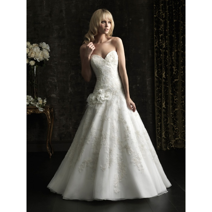 This dropped waist wedding dress has a waistline that for Wedding dress styles for big hips