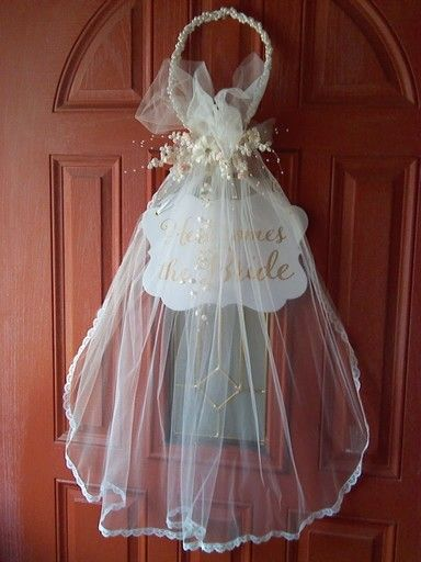 Bridal door decoration i made from bride 39 s communion veil for Wedding door decorating ideas