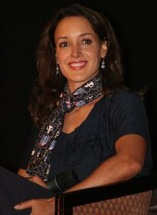 "Jennifer Beals From Wiki -""She is multiracial;[4] her father was Puerto Rican and African American, and her mother is Irish American Beals has said her biracial heritage had some effect on her, as she always lived sort of on the outside, with an idea of being the other in society"" She could be cast as  an Arab, Indian, Latin and African American - no doubt she is a ""person of color"" and beautiful!"