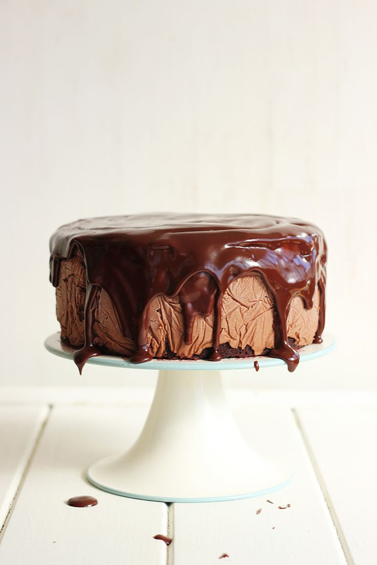 Toblerone Ice Cream Cake - Super chocolatey layers of cake, filled with creamy toblerone ice cream, and topped with honey chocolate sauce and more toblerone!