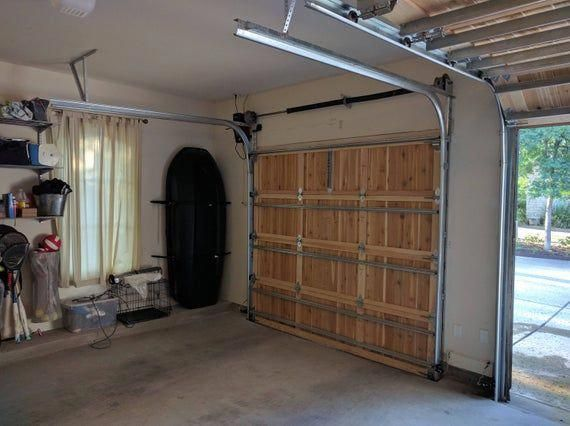 Check Out This First Rate Unique Garage Door What An Ingenious Innovation Uniquegaragedoor In 2020 Wooden Garage Doors Wooden Garage Garage Door Design