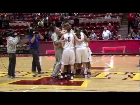 College Basketball player gets engaged before a game