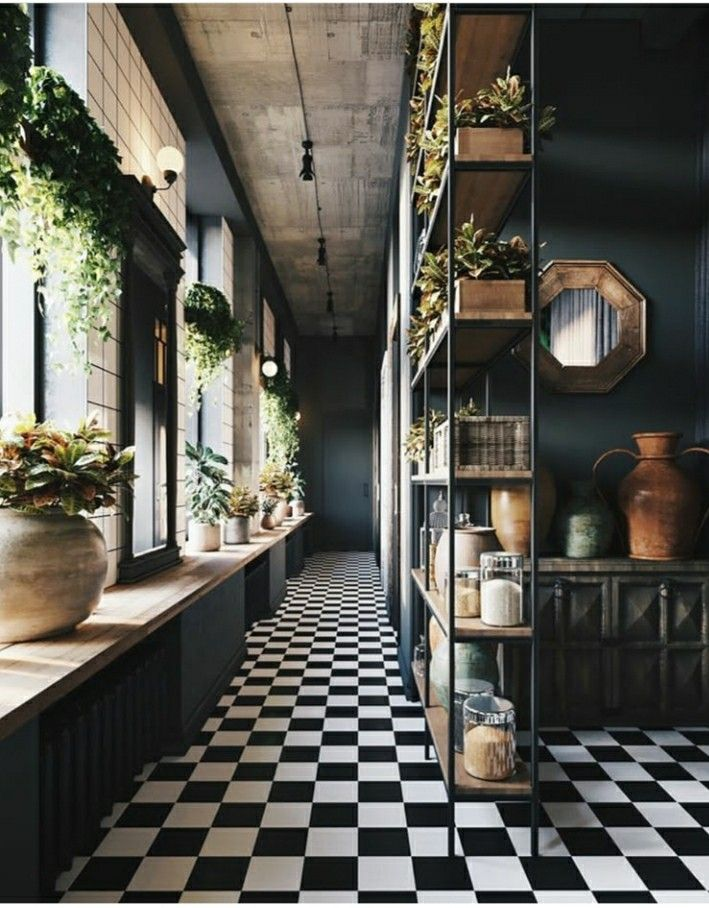 Grow tomatoes and strawberries from hanging planters in the window. Also, dramatic floors and dark walls