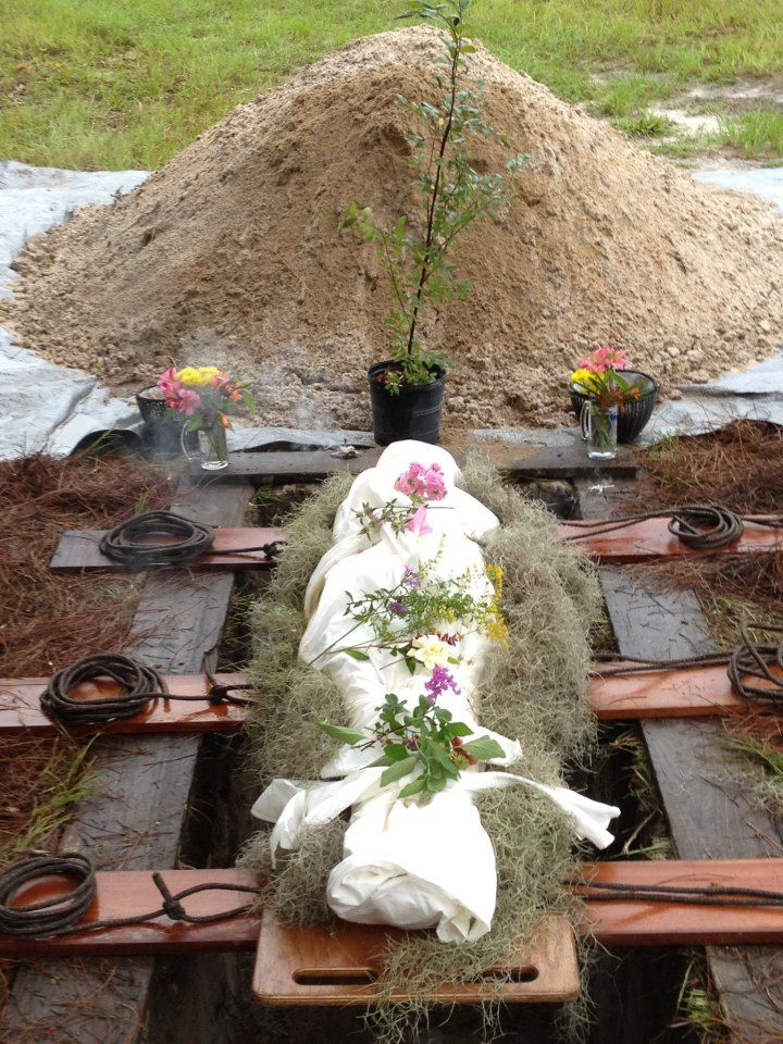 Green burial........I rather like the Spanish moss around the body.