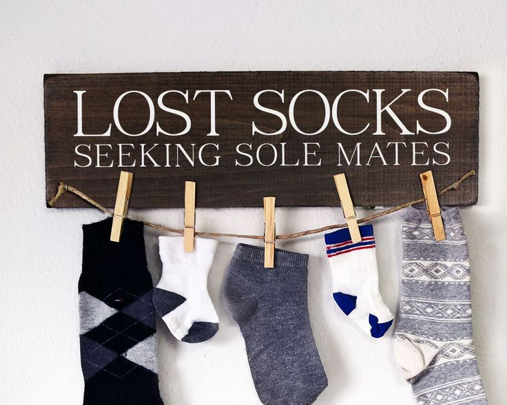 "Lost Socks Sign / Laundry Room Decor : This fun and practical sign is a great way to keep track of those pesky single socks. FEATURES: Size is 5.5"" x 18"" Hangs up about 5-6 lonely socks Includes cloth"