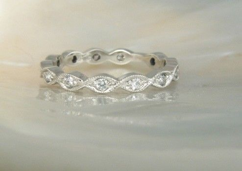 Elegant platinum and diamond eternity band wedding ring with milgrain borders This in ros gold
