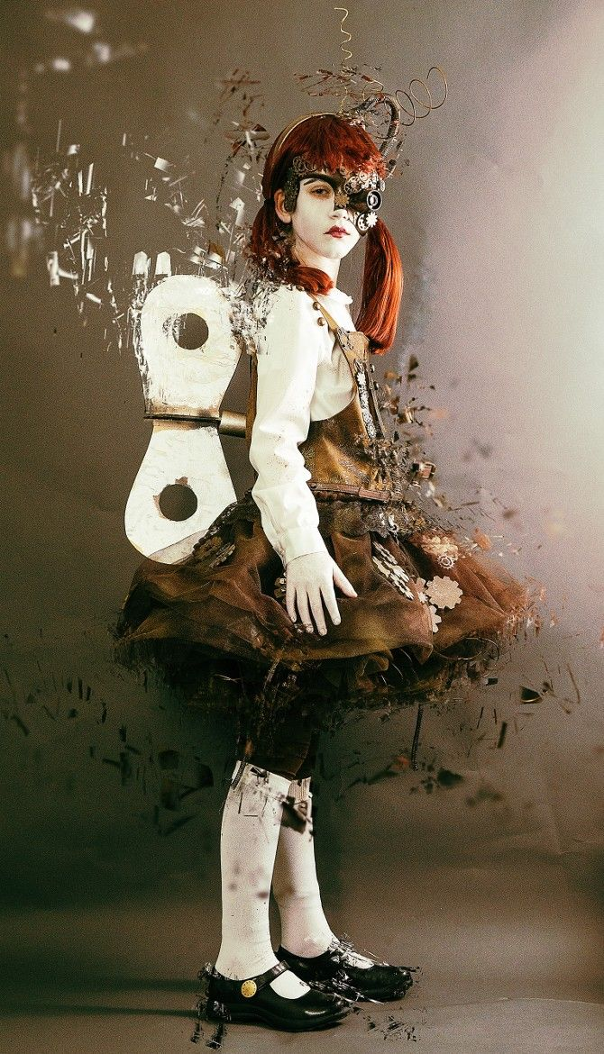 """Arsenic in the shell Steampunk Doll By CS : """"My daughter designed her own Steampunk Cyborg Doll costume for Halloween this year and she and her mom hand made it. The eye piece on the mask is the lens from a point and shoot camera from Goodwill.<<AMAZING"""