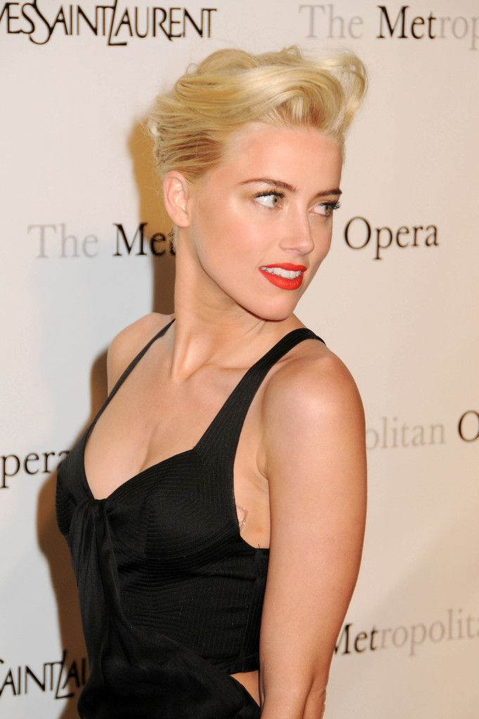 Amber Heard wears a sexy black dress at the Metropolitan Opera premiere of Jules Massenet's 'Manon' in NYC.  March 27, 2012