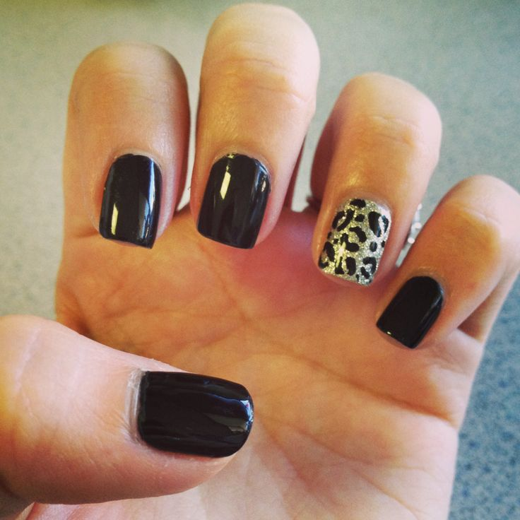 Black nails with cheetah accent nail! Awesome for fall!