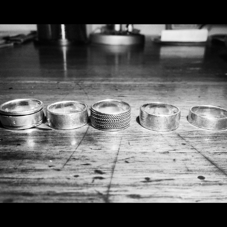 silver rings on wood table
