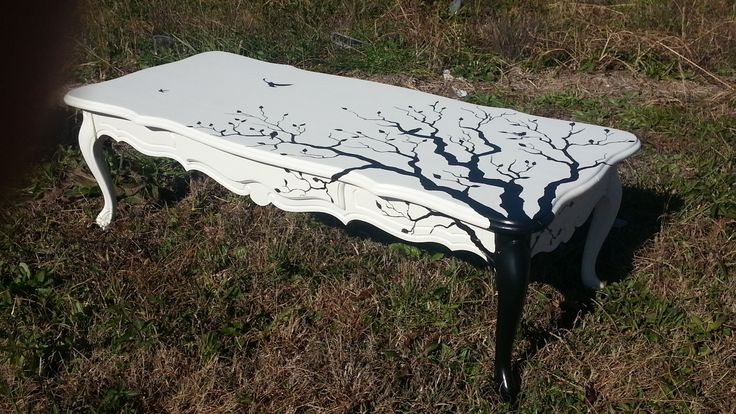 """One-of-a-kind best describes this repurposed Coffee Table. It has been hand painted with tree branchs and birds. The white is an """"old white"""" and the design is hand painted with black. Another piece of  repurposed furniture that is perfectly repurposed at Just Repurposed in Hanceville, AL. www.justrepurposed.com"""