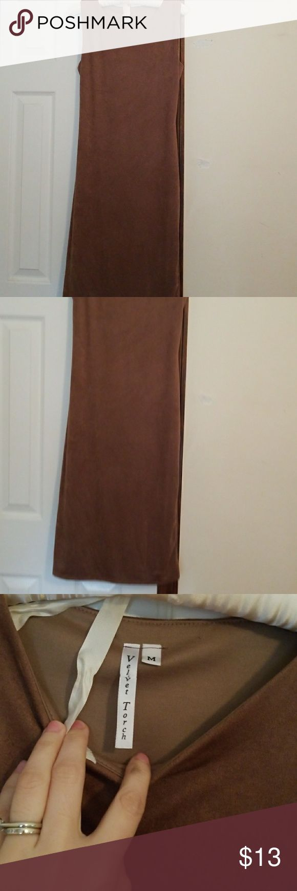 New suede camel bodycon dress size M Suede material soft has extra cover under dress .  Never worn. Like new . Dresses Midi