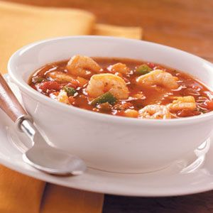 Tomato Seafood Soup Recipe -We love this hefty soup on Sundays during football season. For a little extra zip to rally spirits, we sometimes add red pepper flakes or use jalapeno-flavored tomatoes. It's also delicious with real crab meat. —Mary Adams, Fairport, New York