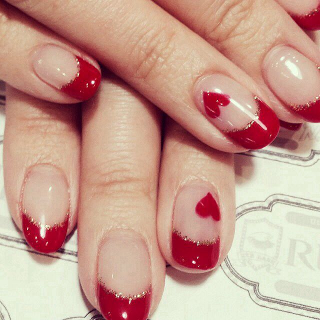 Red French manicure with hearts