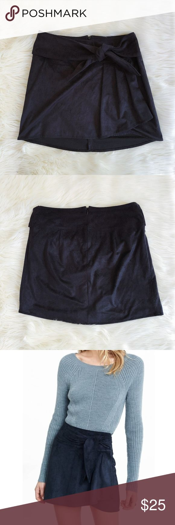 "NWT EXPRESS Faux Suede Wrap Tie Waist Mini Skirt EXPRESS MINI SKIRT  -SIZE 6 -FAUX SUEDE -BLACK -WRAP STYLE -SLIGHT HIGH/LOW HEM -TIE WAIST THAT COULD BE TIED IN THE FRONT OR BACK -LINED -ZIPPER BACK FOR EASY ON/OFF -88% POLYESTER, 12% SPANDEX -MACHINE WASHABLE  APPROXIMATE MEASUREMENTS: -15.5"" WAIST LAYING FLAT -17"" TOP TO BOTTOM (BACK SIDE) -6.5"" ZIPPER  -BRAND NEW WITH TAGS (ORIGINALLY $49.90) Express Skirts Mini"