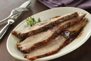 Sweet and Savory Coca Cola Brisket: Slices of slow cooked brisket with gravy make an ideal holiday meal