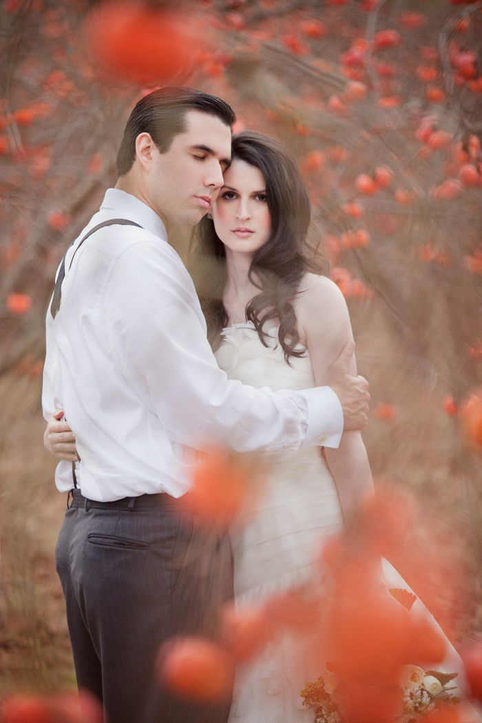 put something interesting in the foreground, but focus on them.  this modern romance - wedding photography