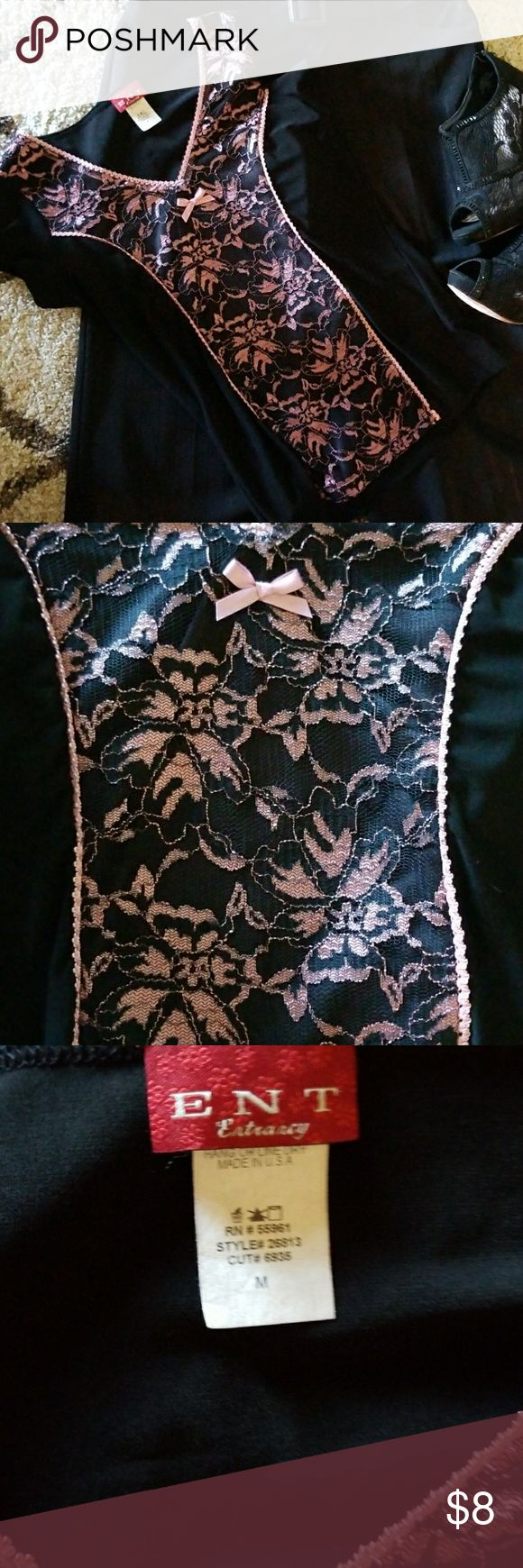 Black and Pink Short Sleeve Top with Flowers. Excellent used condition..... Black short sleeved top with Black lace with the Pink flowers and pretty pink trim on the front of the top. Size Medium. Tops