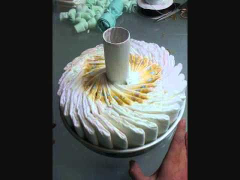 Tutorial on how to make a diaper cake with the no-roll technique. So much better than having all of those cumbersome rubber bands!!!