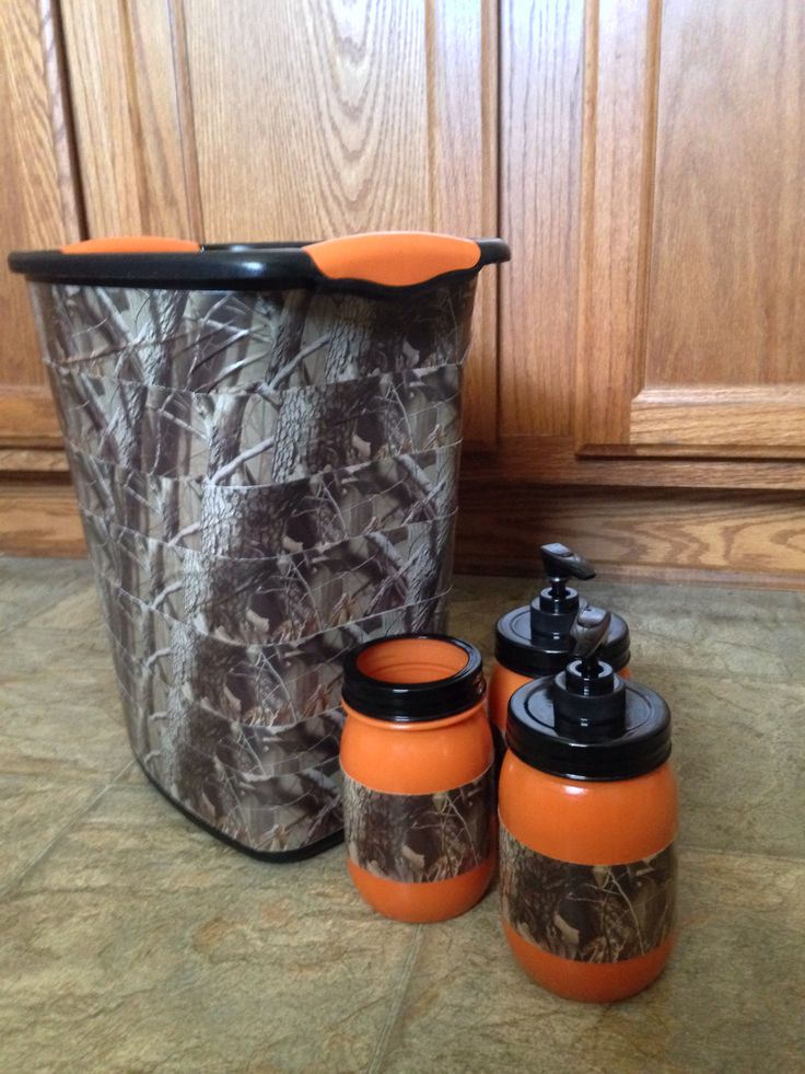 Camo bathroom set. Made from a plain black trash can and three mason jars