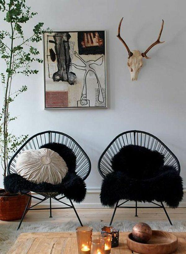 les chaises papillon en acier noir