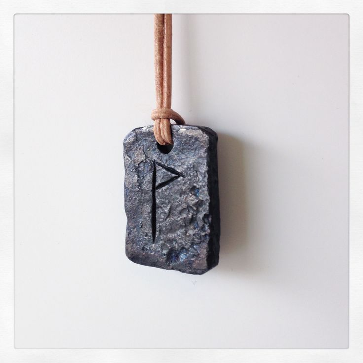 Hand forged and oil burned wunjo-pendant. Made in Helsinki.