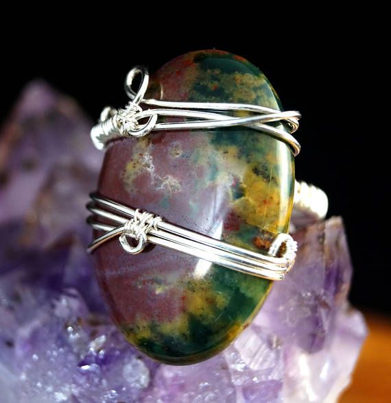 A delicate, unique, handmade, wire wrapped ring with Bloodstone.  Ring was designed and made by Me, using an extremely labor-intensive and precise wire-wrapping technique, with silver 925, 930 and 999. On a buyers request size can be adjusted by plus 1 or minus 1.  Dimensions: Jewelry Size: 11 EUR ( 6 USA ) Inner diameter: 16 mm Width of ring: 3 mm Stone size: 3,1 cm (1.22 inch)   You receive this unique ring in jewelry box, so it is ready to be a gift.  Refunds and Exchanges:  If you are…