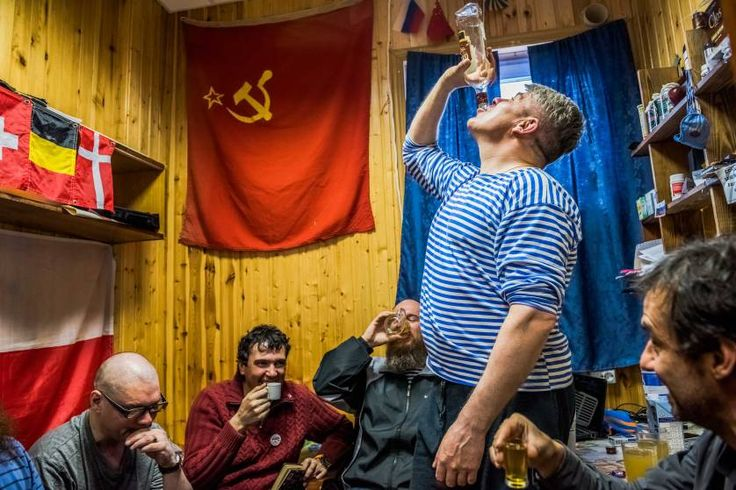 Daily Life, 1st prize stories. The winter expedition crew of Russian research team and a Chilean scientist drink Samagon, a homemade vodka, in a bedroom of the Bellingshausen Antarctica base; Fildes Bay, Antartica, Dec. 28, 2015.