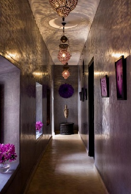 The Morrocan style lighting makes all the difference in this violet schemed hallway.