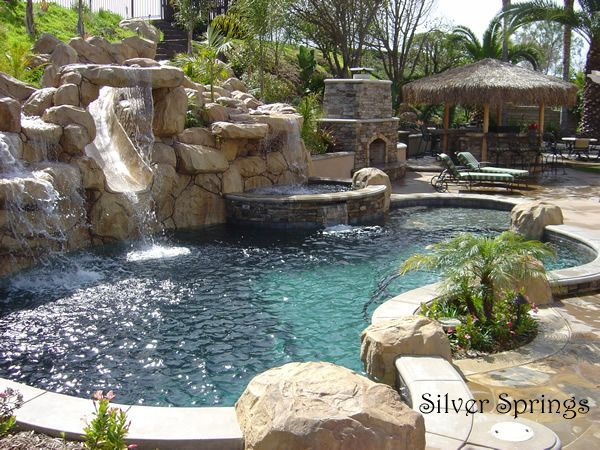 Backyard pool pure luxury slide hot tub fire place - What do dreams about swimming pools mean ...