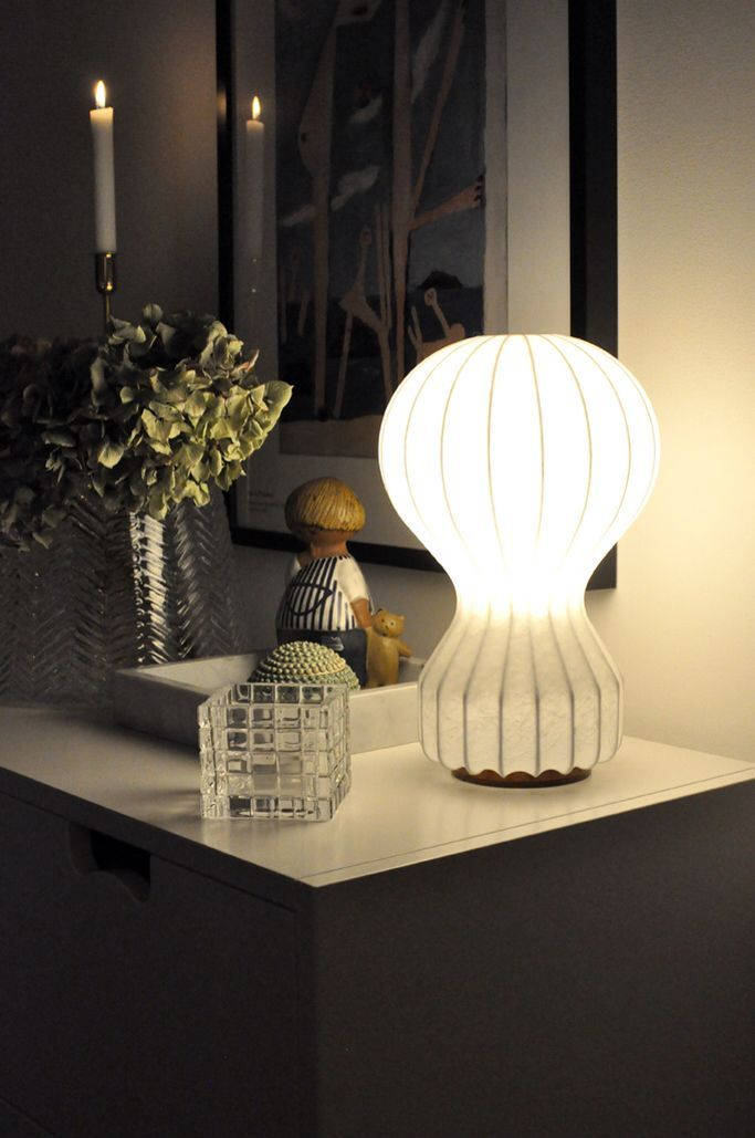 Flos gatto brings a soft glow that complements the candlelight in this elegant interior