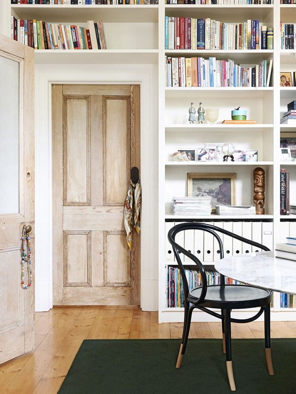 Front sitting room / study. Thonet Le Corbusier chair, floor to ceiling bookshelves and beautiful timber internal doors. Photo -Eve Wils...