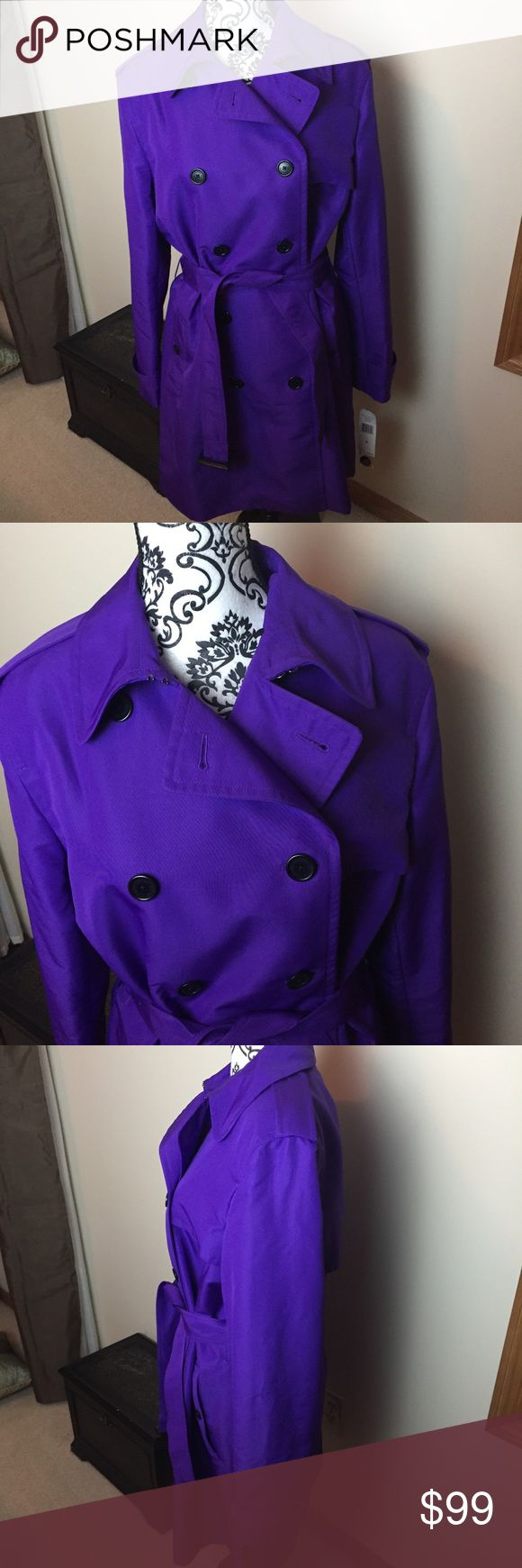 """NWT Ralph Lauren Vibrant Purple Trench Coat Excellent condition, new with tags!! Stunning bright purple trench, that is bound to get you attention!! Black buttons, adjustable tie, fully lined. Pit to pit measures 24"""" wide, waist measures 22"""" wide and the total length from top to bottom is 38"""" long. Ralph Lauren Jackets & Coats Trench Coats"""