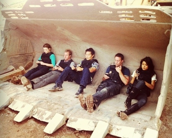 Hawaii 5-O cast all on there cell phones :P