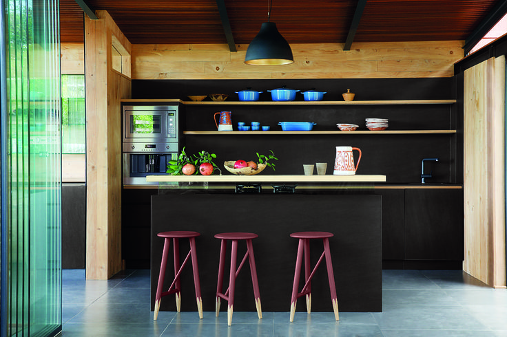 Plascon's Auberge 66 creates a backdrop to show off natural wood shelving and beautiful kitchenware in open plan spaces.