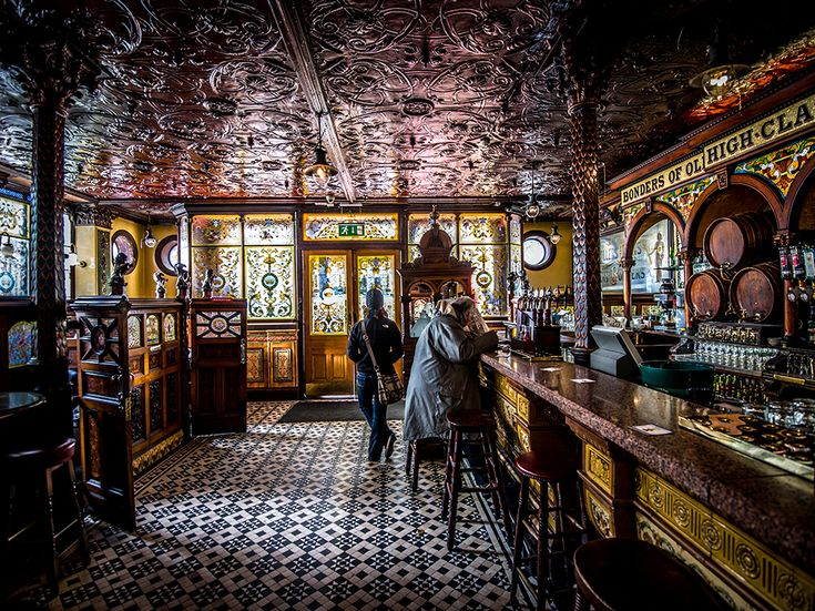"Crown Liquor Saloon, Belfast: Belfast's Crown Liquor Saloon dates back to 1826, though the elaborate tiling, glasswork, and woodwork wasn't added until the 1880s. Now owned by the National Trust, the Northern Ireland pub has been restored to its ""full Victorian splendor."" Photograph by Lorenzo Mosica, Archivolatino/Redux. November 13, 2013"