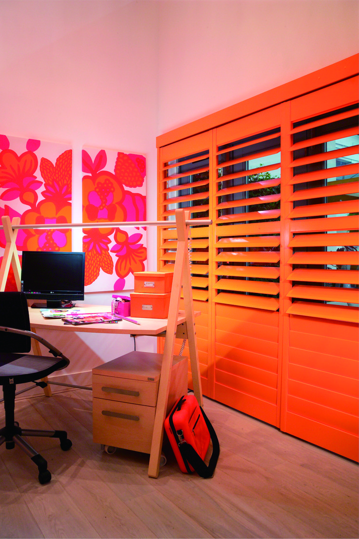 Painted bypass shutters for children's rooms.