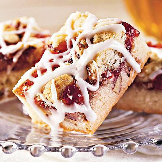 Streusel Strawberry Bars  ..      Tender butter cookies filled with strawberry jam make the perfect anytime treat. Cut down on prep time by topping them with powdered sugar instead of homemade icing.