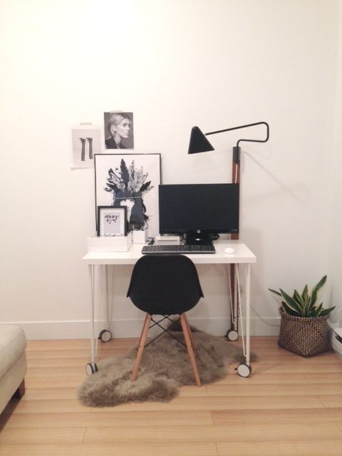 Our desk is from IKEA and houses an IKEA wall lamp we secured to a piece of old wood my husband found. We move stuff around too much we didn't want to commit to tearing up our drywall yet.