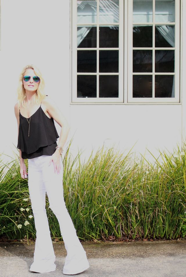 Flare white jeans on Erin from Busbee Style.
