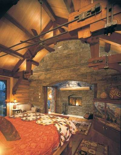 "Love the ceiling and metal tie rods; amazing fireplace   TLC Home ""Cabin Decor Idea: Today\'s Log Looks"""