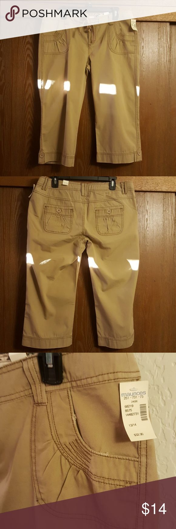 Maurices Khaki Capris Size 13/14 NWT NWT Size 13/14.  Khaki Capris with button, zipper and tie front.  2 front pockets and 2 back pockets.   Button tabs closures at the hems.  Gathered front pocket detail.  Waist lying flat is 18.5 inches. Maurices Pants Capris