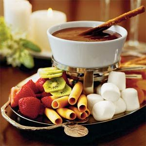 Who can resist Chocolate Fondue?!?    Ingredients  1 cup whipping cream  3 (4-ounce) semisweet chocolate bars, chopped  2 tablespoons coffee liqueur or other flavored liqueur  Assorted cookies, pretzel sticks, fruit, marshmallows $  Preparation    Microwave whipping cream and chocolate in a microwave-safe glass bowl at HIGH 1 1/2 to 2 minutes, stirring every 30 seconds. Stir in liqueur.  Transfer to a fondue pot; keep warm, stirring