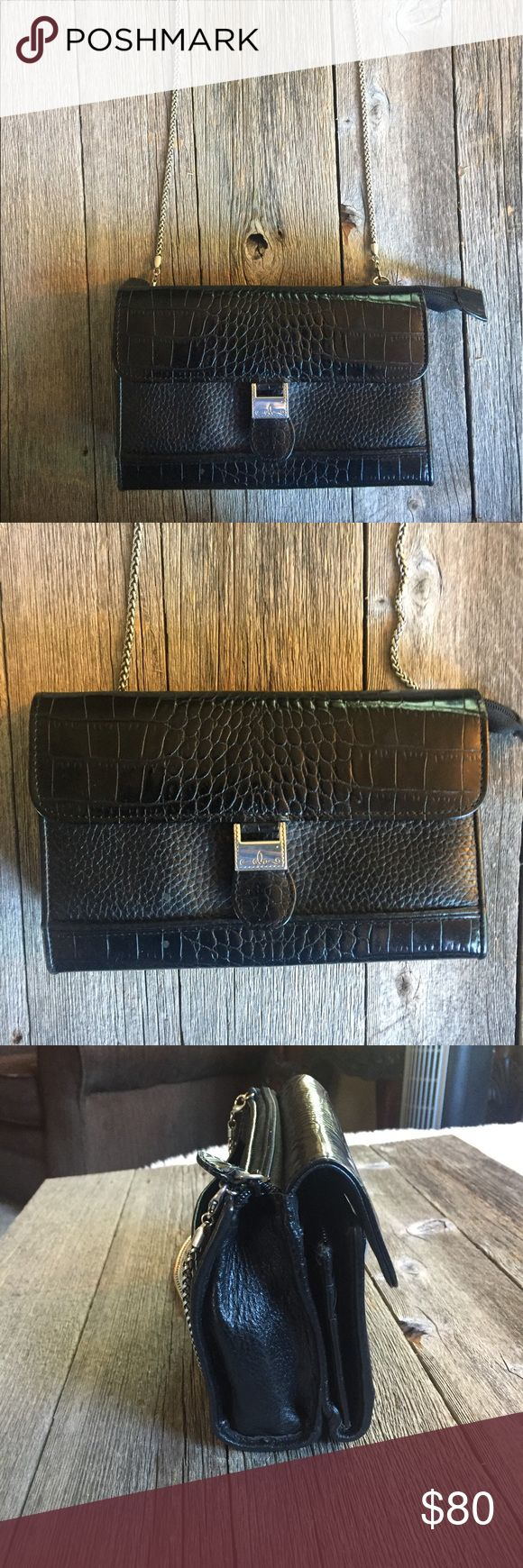 Brighton black purse with removable chain strap Black • Brighton • purse • folds open • chain is removable to make into a clutch • great condition • lots of pockets and zipper storage to stay organized • 7.5 inches x 4.5 inches Brighton Bags