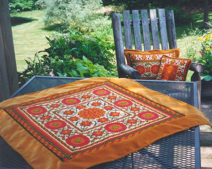 Suzani Moghul pattern in 03 colors, available in 5 sizes for stitching - the largest size shown here as a table throw