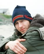 "Kenny Marsh in the programme ""Two Thousand Acres of Sky"" portrayed by Paul Kaye"