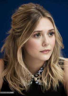 Elizabeth Olsen with beach waves and pretty day makeup - book the look now at…