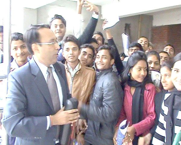 A crowd of students of Model College Janakpur cheering up after the interaction program by the founder director of JKK Foundation in the phase of Youth Empowerment Project.